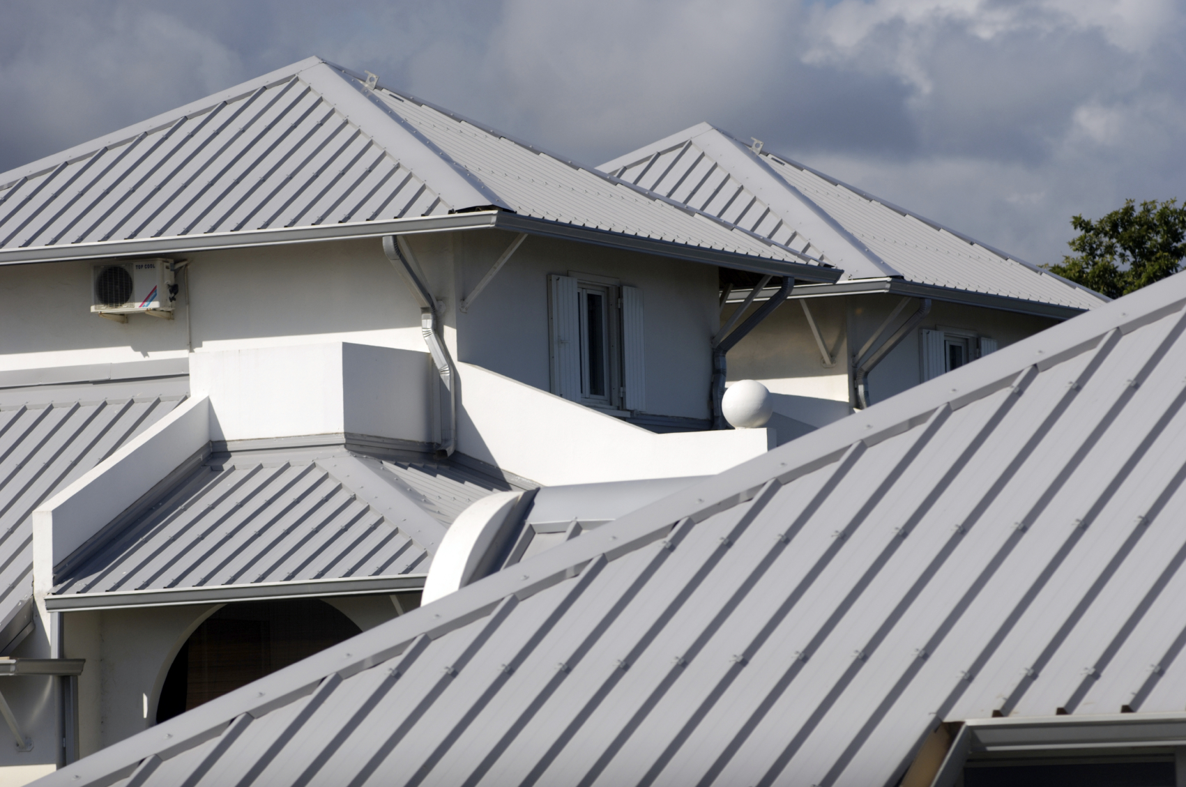 Metal roof metal roof value house for Images of houses with metal roofs